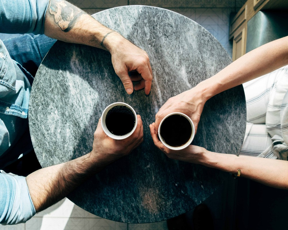 Two people meet over coffee